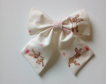 Bow clips and bobbles made with Belle & Boo fabric