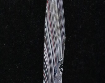 Fordite cabochon, red white black gray, 4.5ct