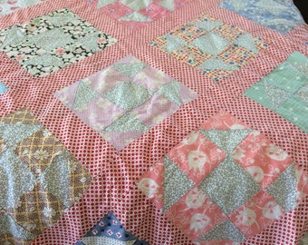 Charming Vintage 1930's quilt top.  Sashing is red with white dots.  Still very colorful.  Beautifully sewn. No stains, no tearsor fraying.
