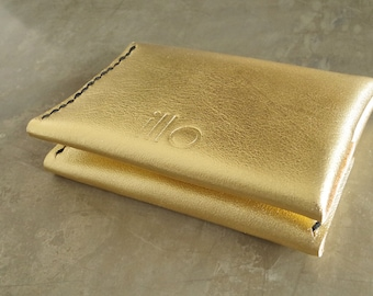Gold leather wallet hand stitched minimalist 4 pocket card holder holds up to 10 cards brass snap 1 piece construction black tiger thread