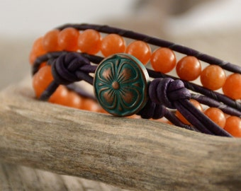 Orange and purple beaded bracelet. Double wrap leather bracelet