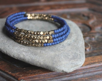Kalimantan Stacking Memory Wire Bangle Bracelet with Monaco Blue Glass and Faceted Brass Beads - Exotic and Chic