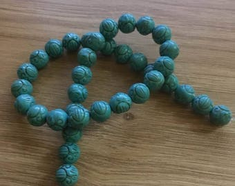 row synthetic turquoise beads 10 mm