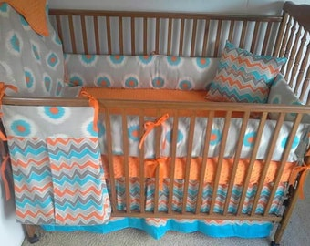 Gray, orange and blue baby bedding