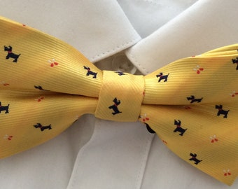 Yellow bow tie with navy dog pattern
