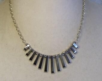 "Cynthia Lynn ""METRO METALLICS"" Silver Graduated Hematite  Stick Bead Cleopatra Necklace"