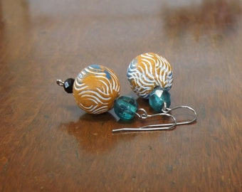 Funky wavy patterned orange and blue clay earrings