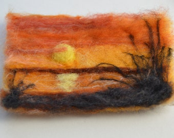 Folk art needle felted sunset of the beach, shadows and seagrass