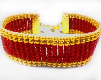Ruby red and gold bracelet, woven on a bead loom, gold toggle clasp