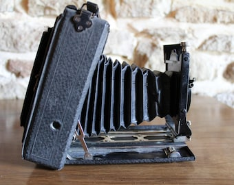 Antique Camera. Folding antique camera with case.