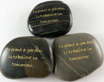 To plant a garden is to believe in tomorrow - Set of 3 Engraved River Rocks