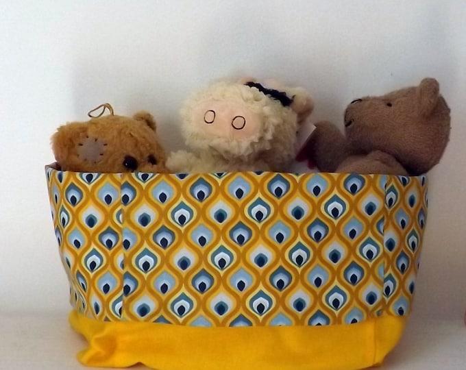 Large reversible yellow and blue storage fabric basket toys, towel, interior storage