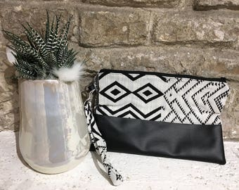 Black and white leather clutch bag