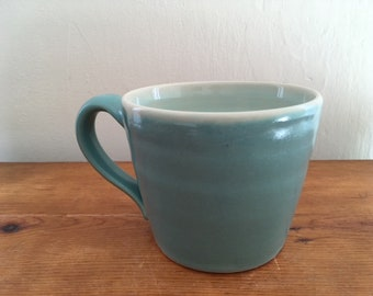 Blue mug for coffee, tea, cocoa