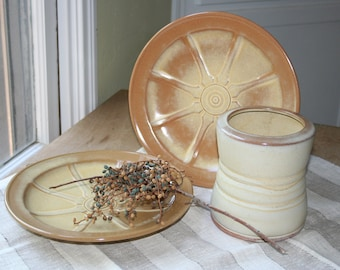 Instant collection of Frankoma wares. Wagon wheel, Frankoma plates, Frankoma vase, tan vase, tan plates, off white, Frankoma Wagon Wheel