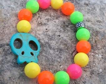 SKULL Bracelet Brightly Colored Round Bead with Turquoise Blue Flat Skull Stretchy Bracelet