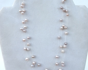 natural floating pearls   ...      vintage  pearl  necklace   ...   fresh water pearl choker