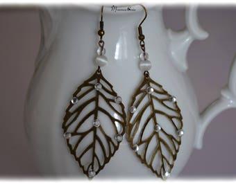 Leaf and rhinestone earrings,