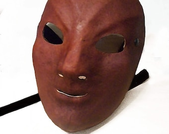 Female neutral mask in Lecoq Sartori style androgynous leather larp renaissance wicca pagan burning man fantasy commedia arte comedy theatre