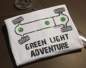 Vanagon Syncro Green Light Adventure T-shirt.  Full front print on a 100% cotton preshrunk Tee. White shirt, Black/Green print.