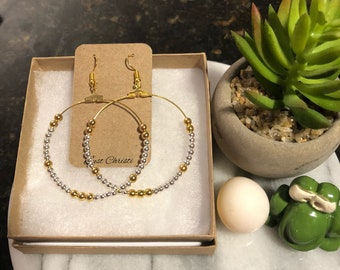Gold and silvef beads with gold hoop earrings