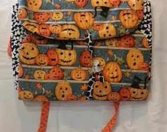 Festive fall pumpkin and cat casserole carrier