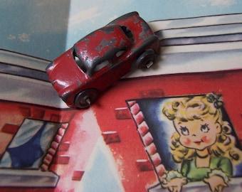 wee tiny red metal car