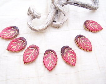 7 red veined gold leaves