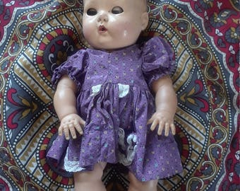 Vintage doll with dress and sleepy eyes