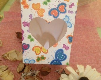 white boxes with colored butterflies and with transparent heart