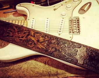 Hand crafted custom and one off design guitar straps made to order.