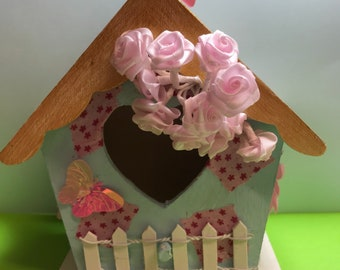 Quirky hand decorated birdhouse