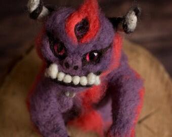 Champ the fluffy demon, cute little monster, creature sculpture, three eyed mascot