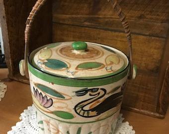 Beautiful hand painted crock with lid. Banboo handle. Ice bucket.