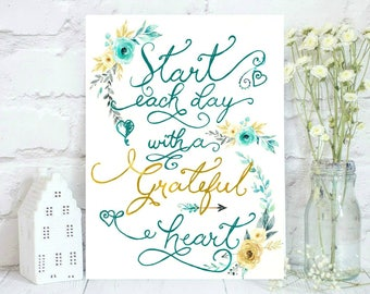 Watercolor turquoise and gold flowers with quote: Start each day with a grateful heart.