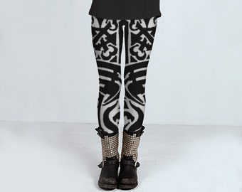 Black and white leggings, handmade punk rock style leggings with bones line drawing by Felicia Stevenson