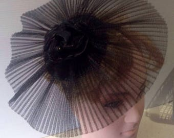 black pleated crinoline fascinator  on sinnamay  base, on satin  bound headbandwith black silk flower