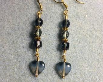 Milky  montana blue Czech glass heart bead dangle earrings adorned with montana blue Czech glass beads.