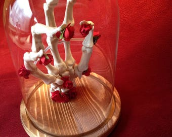 faux taxidermy skeletal hand with forever flowers