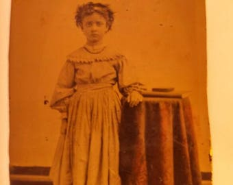 Antique Tintype of Young Girl Wearing a Long Dress Standing by Table