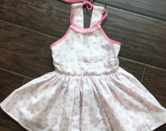 Light purple and white floral dress with pink trim.