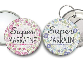 A pink Super liberty godmother mirror and a blue Super liberty Godfather bottle opener
