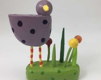 bird in a grassy patch figure | bird sculpture | purple bird | christmas putz | tiny forest | build a forest | woodland scene