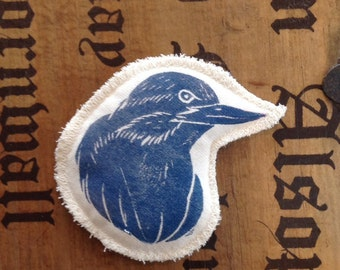 Hand printed bird badge