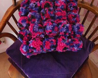 Handmade chunky crochet and pompom cushion