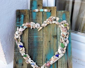 HEART beads and shells on pallet wood