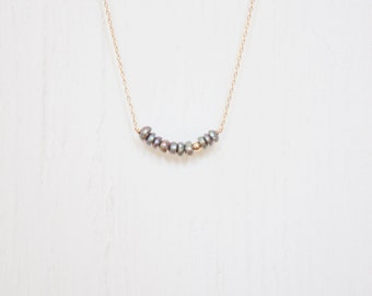 Handmade delicate gemstone necklace. Gold filled and freshwater pearls beads on a  14kt gold filled chain.