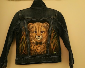 Hand painted baby cheetah with bow tie on child's denim jean jacket