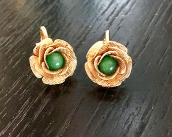 Vintage 1968 Pat.P signed earrings, clip-on, gold tone petals with green stone, excellent condition.