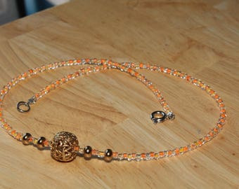 Orange and yellow seedbead necklace, with gold centerpiece